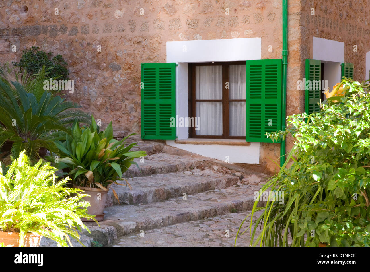 Fornalutx, Mallorca, Balearic Islands, Spain. Green-shuttered window in the heart of the village. Stock Photo
