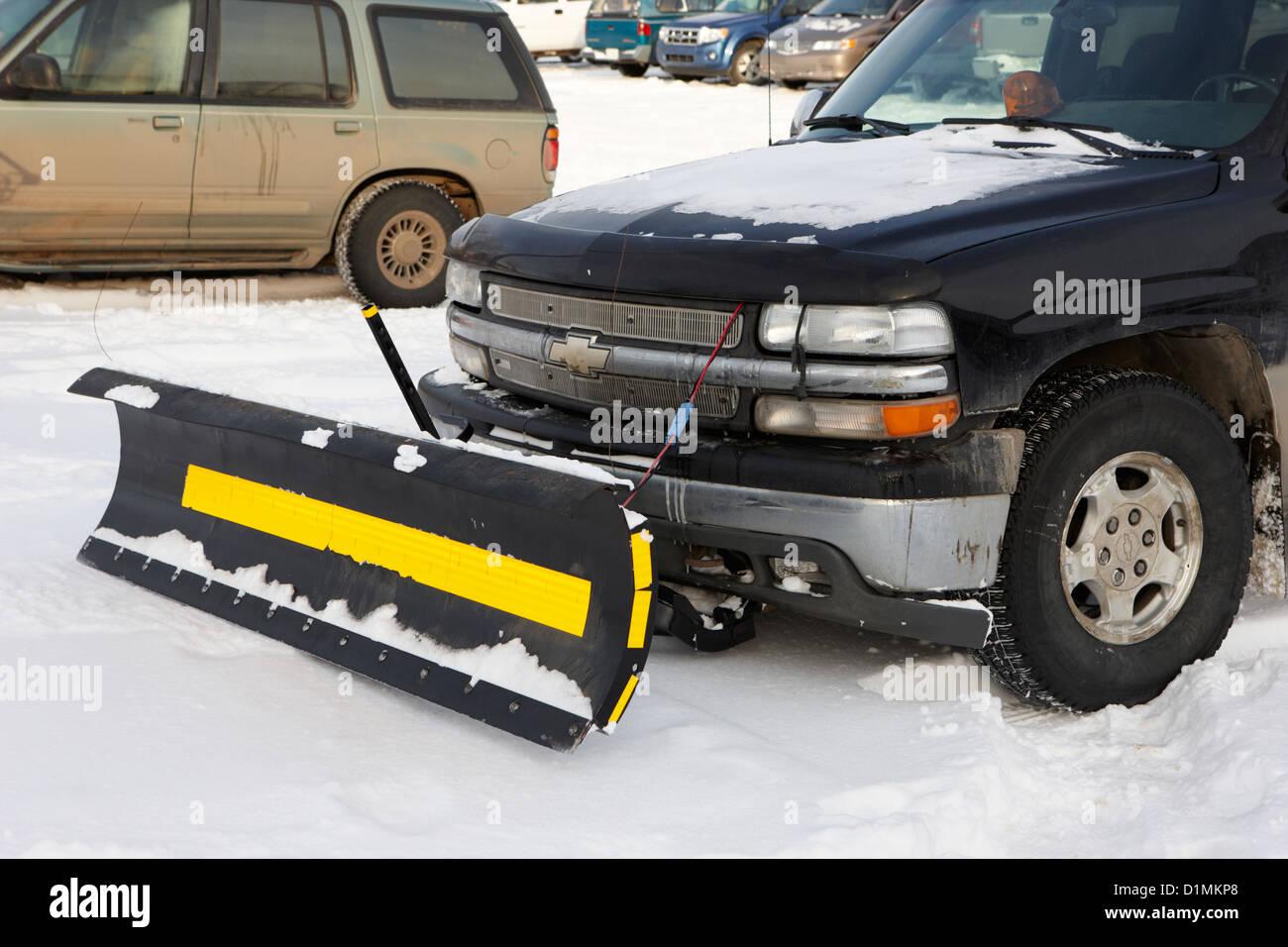 pickup truck fitted with snowplow in car park Saskatoon Saskatchewan Canada - Stock Image