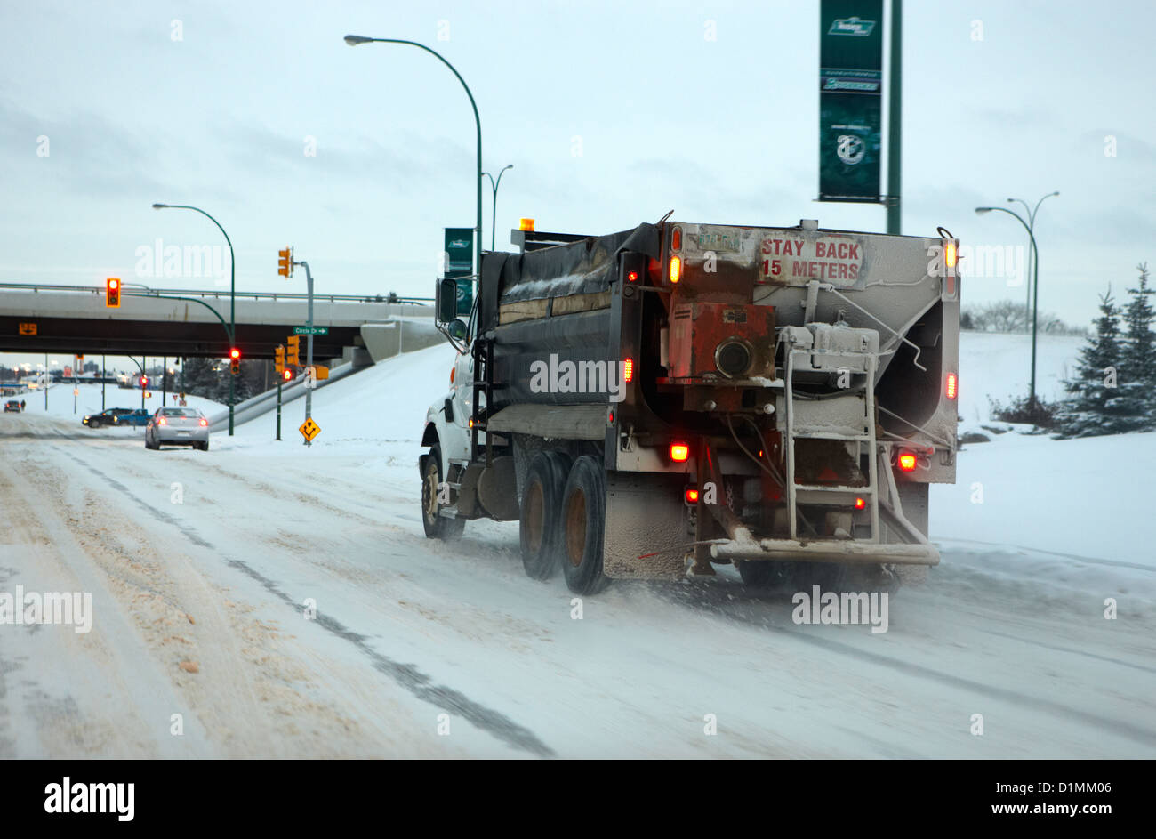 municipal city truck spreading grit and salt on roads in Saskatoon Saskatchewan Canada - Stock Image