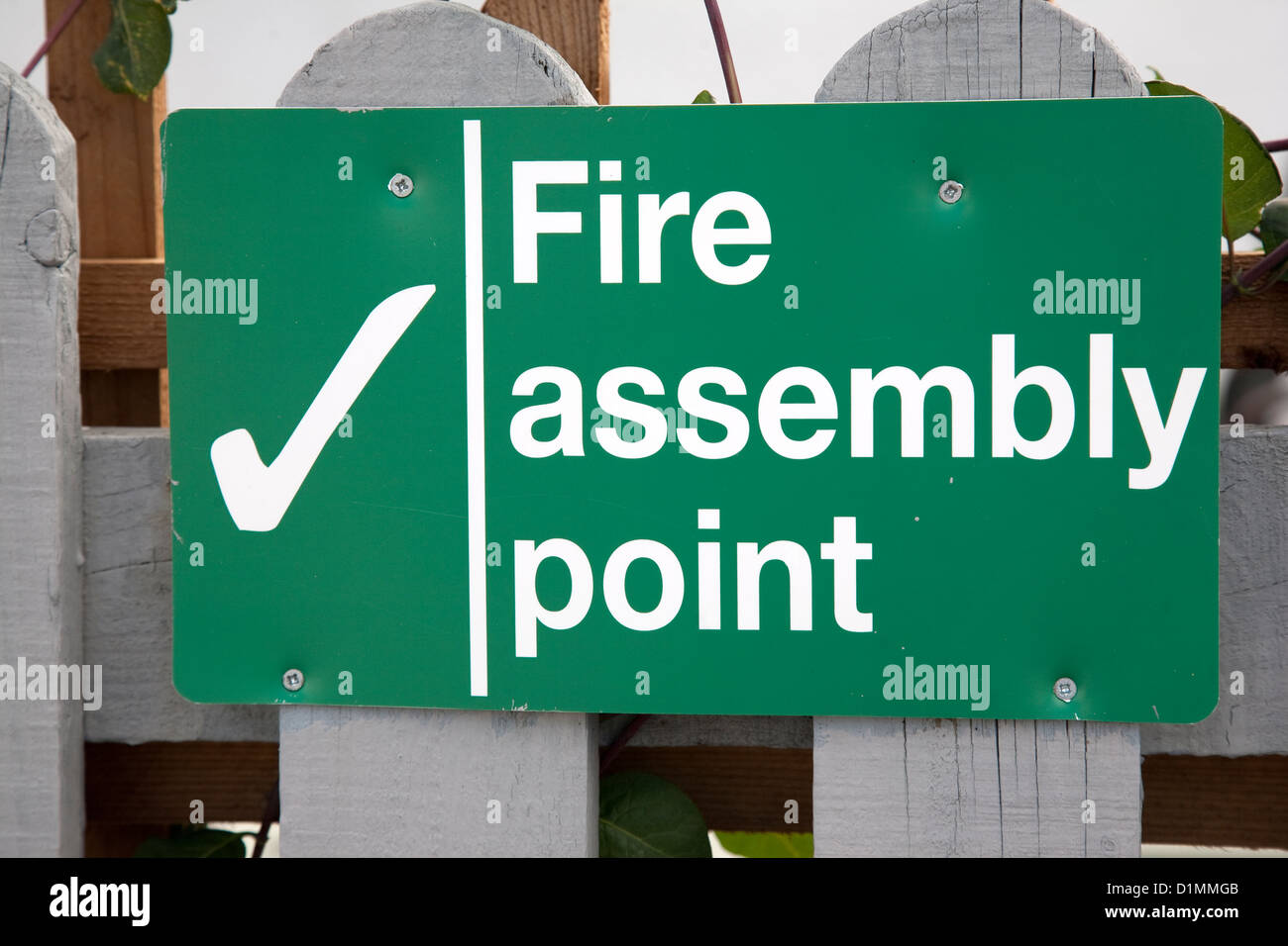 Green UK Fire Assembly Point Sign - Stock Image