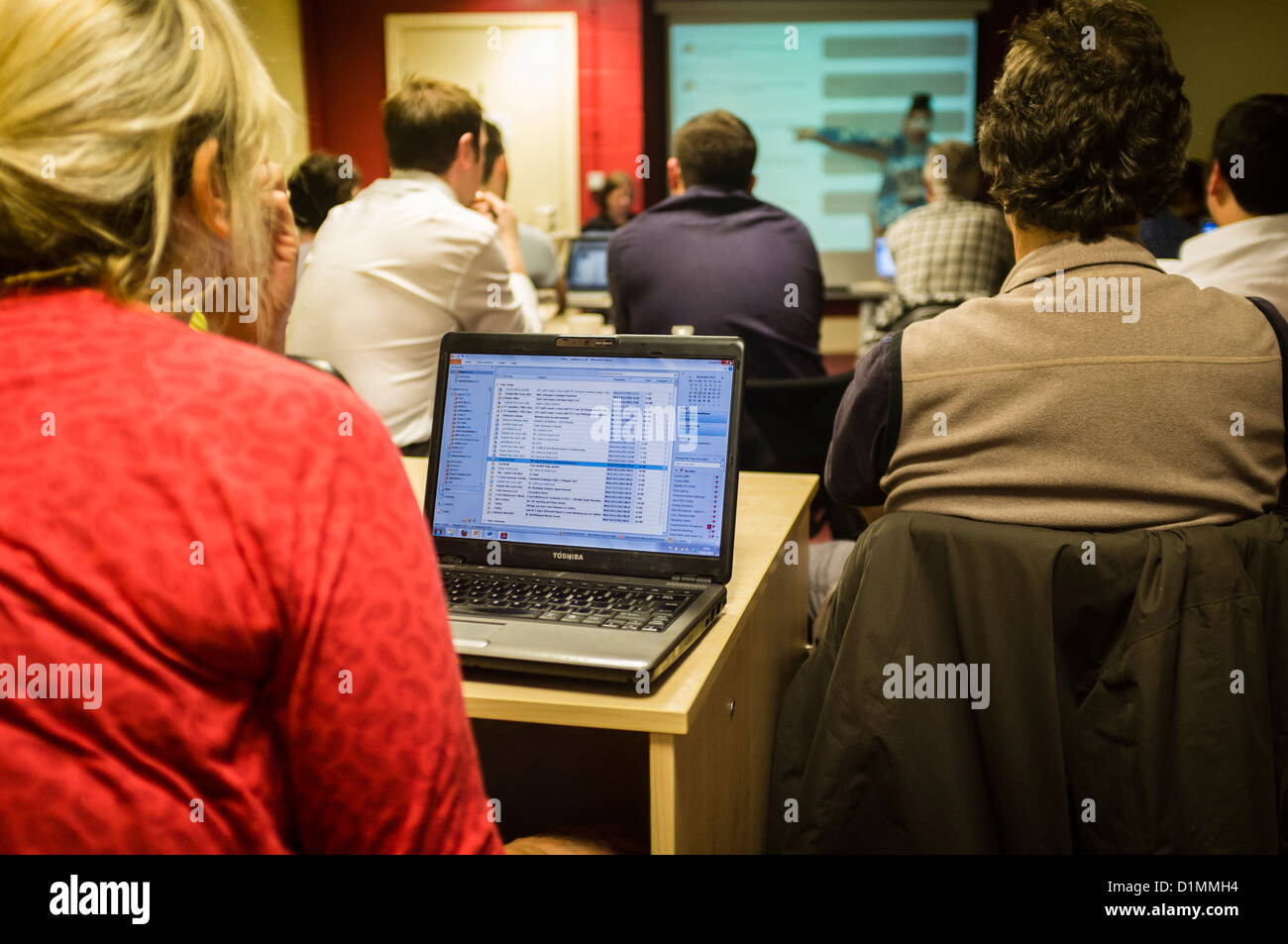 Journalists with laptop computers in a workshop class on how to use Social Media (Facebook and Twitter) in professional - Stock Image