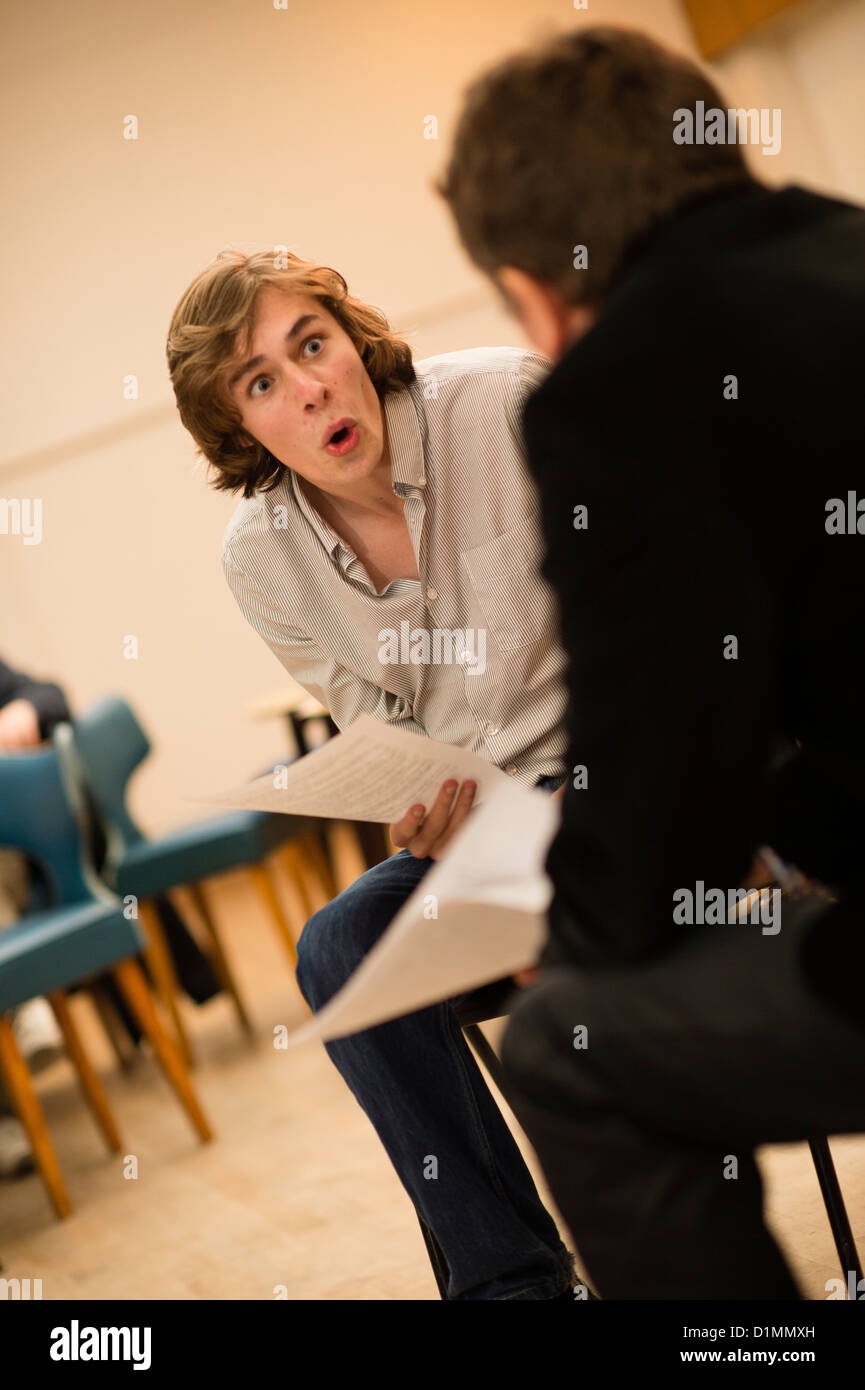 Two amateur actors in a 'script in hand' rehearsed reading of new theatre writing workshop, UK - Stock Image