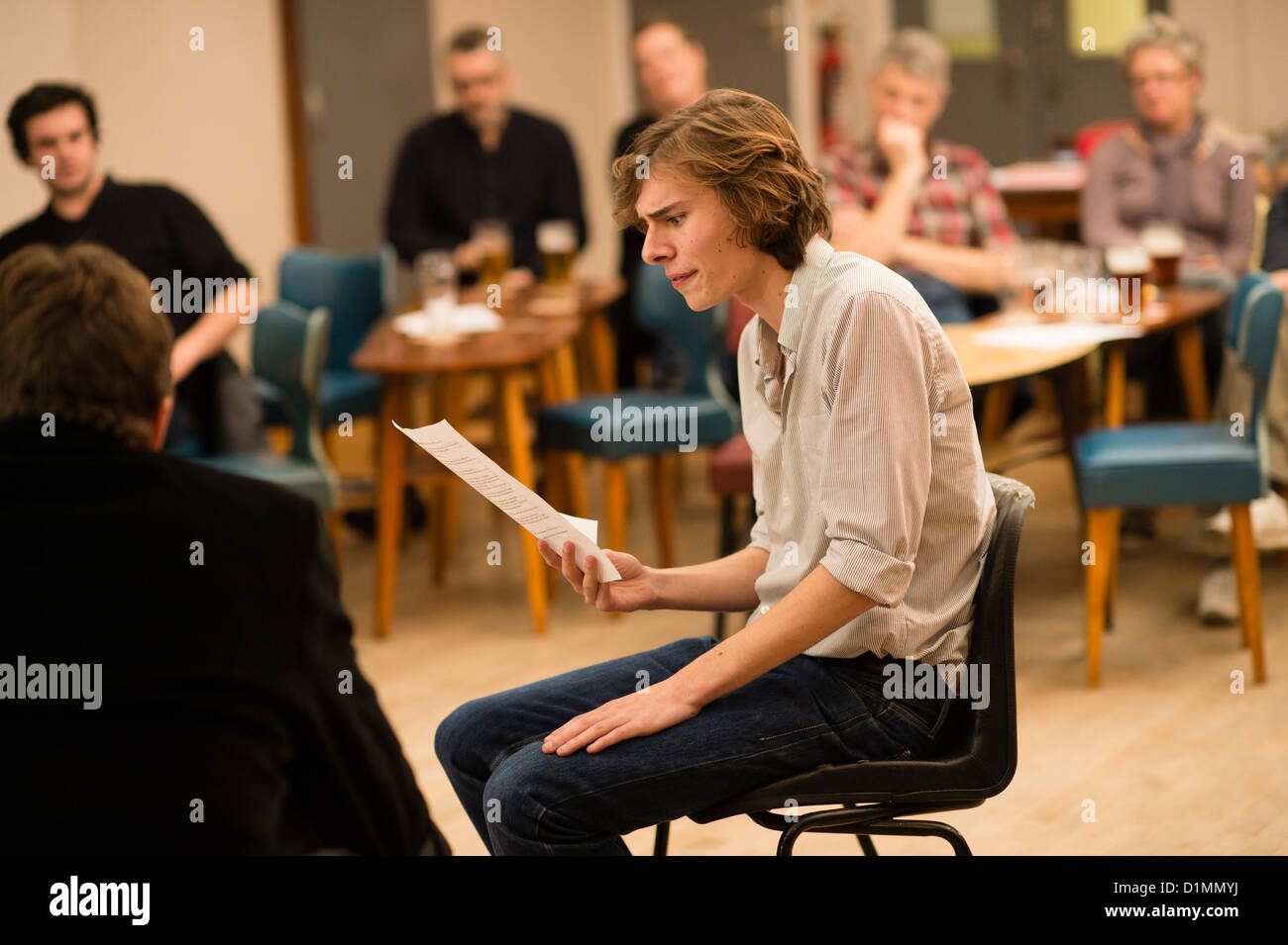 Amateur actors in a 'script in hand' rehearsed reading of new theatre writing workshop, UK - Stock Image