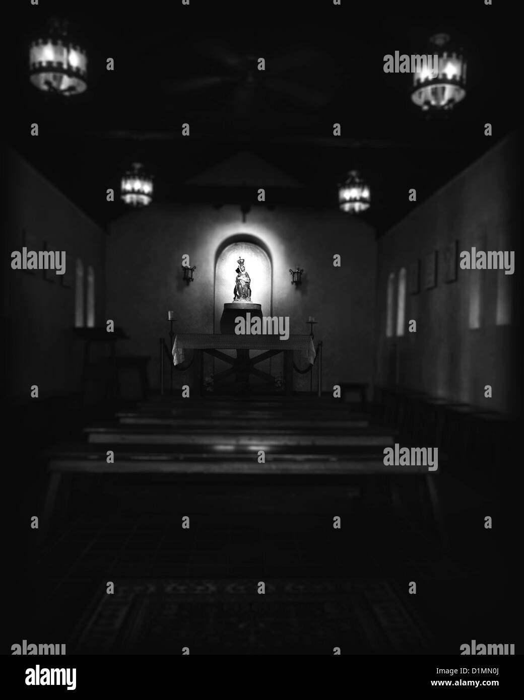 Black and white photograph of the inside of a small church. Our Lady of La Leche Shrine, St. Augustine Florida - Stock Image