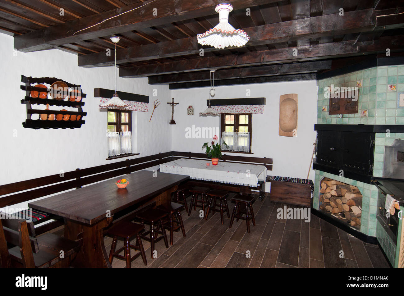 Traditional kitchen and dinning room with ceramic stove - Stock Image