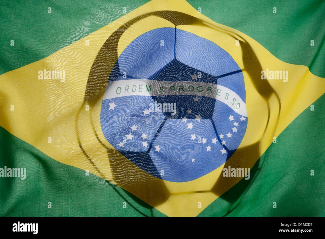 Brazillian flag and football flag - Stock Image