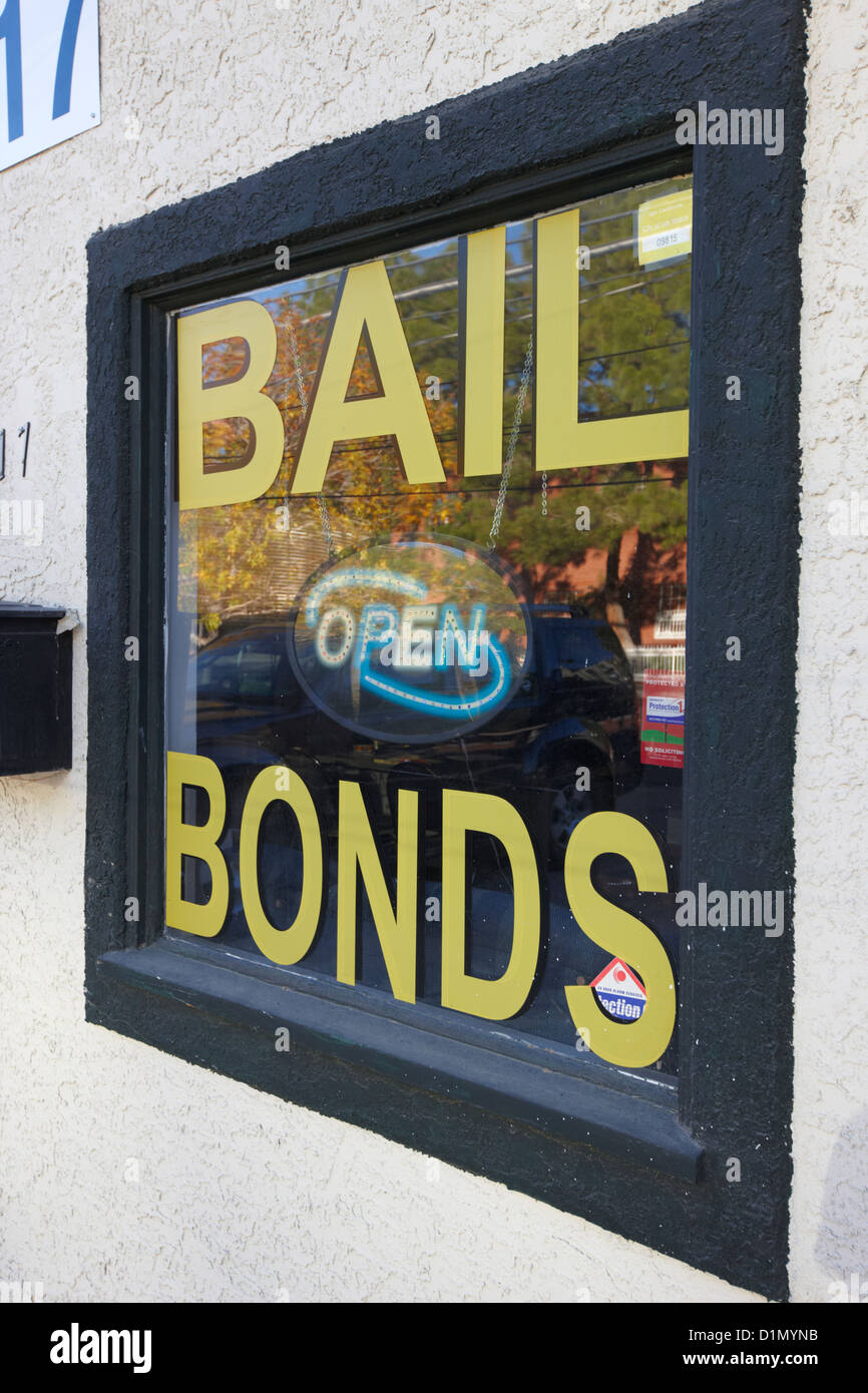 bail bonds open sign in a window Las Vegas Nevada USA - Stock Image