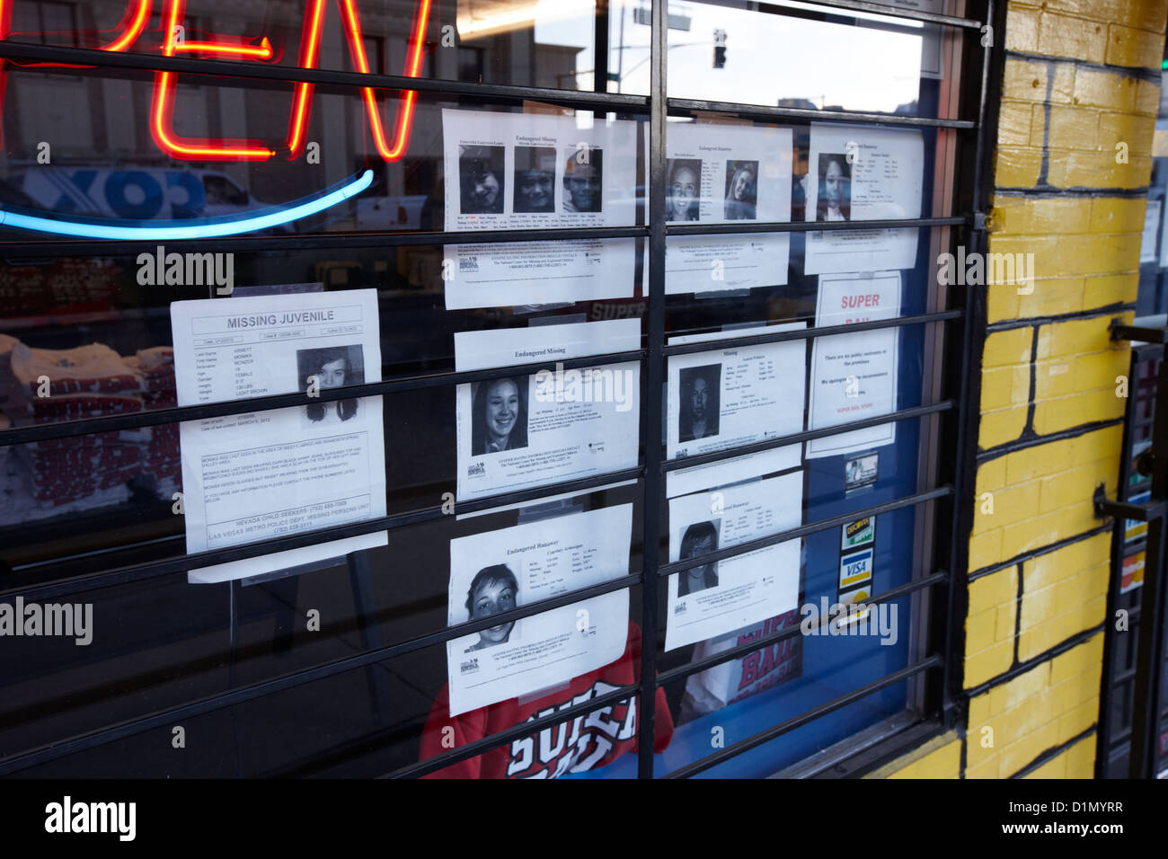 missing persons notices in a window of a store in Las Vegas Nevada USA - Stock Image