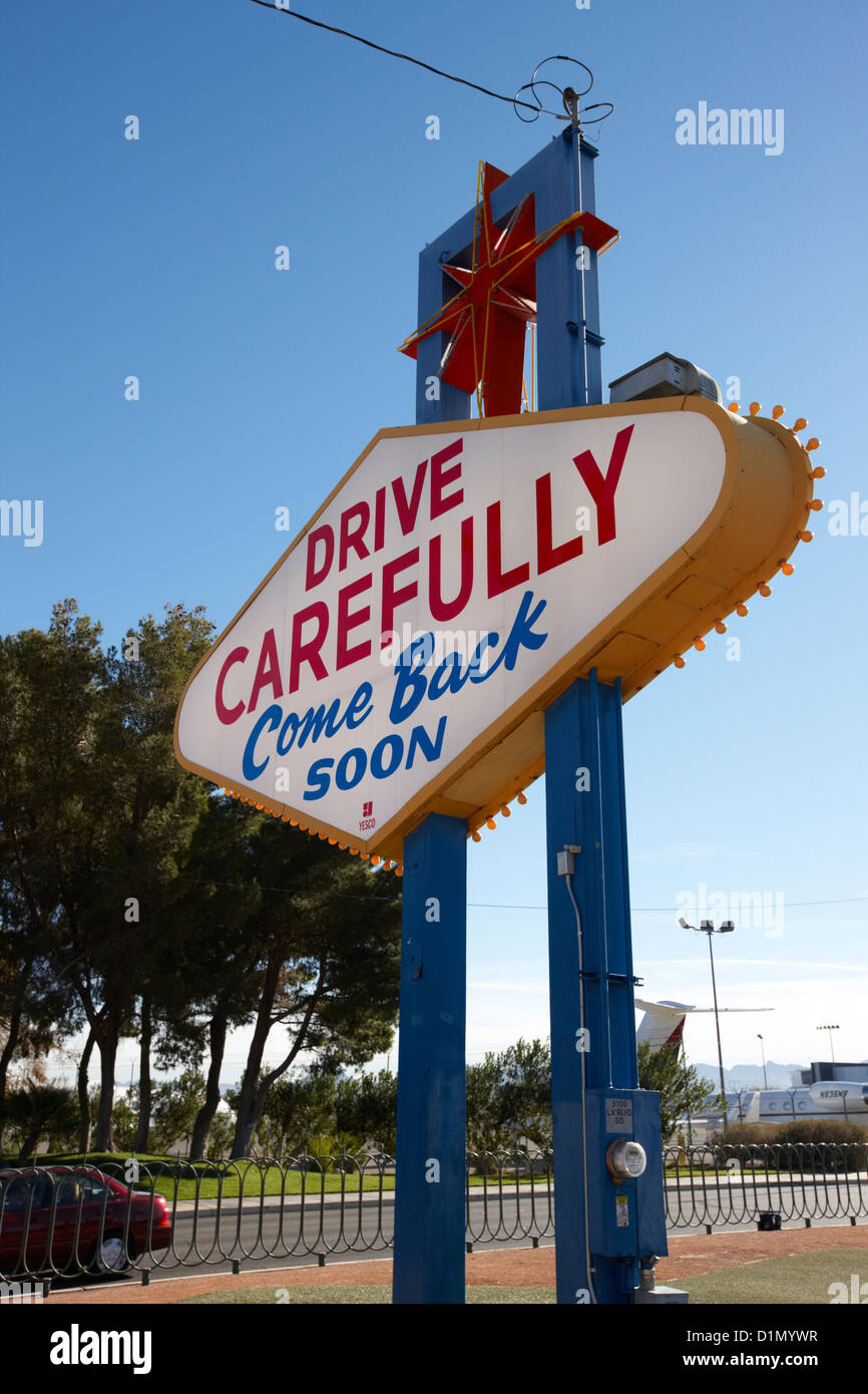 drive carefully come back soon on the rear of the welcome to Las Vegas sign Nevada USA - Stock Image