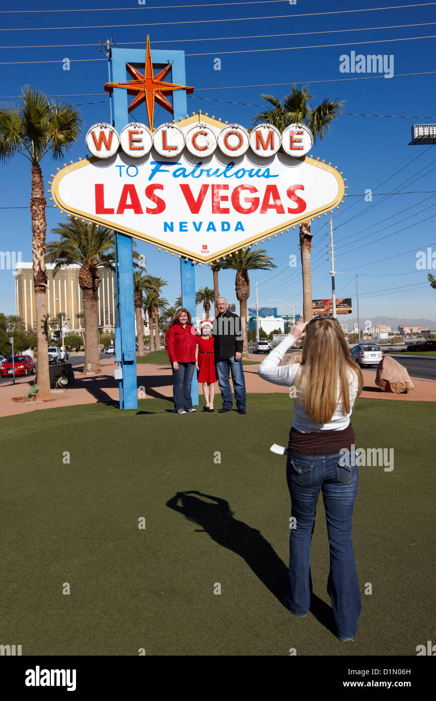 tourists taking photos at the welcome to fabulous Las Vegas sign Nevada USA - Stock Image