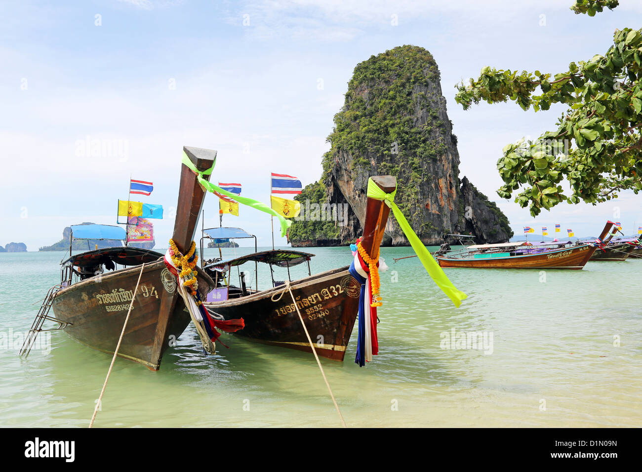 Traditional Thai long tail boats at Phranang Cave Beach, Railay Beach, Krabi, Phuket, Thailand - Stock Image
