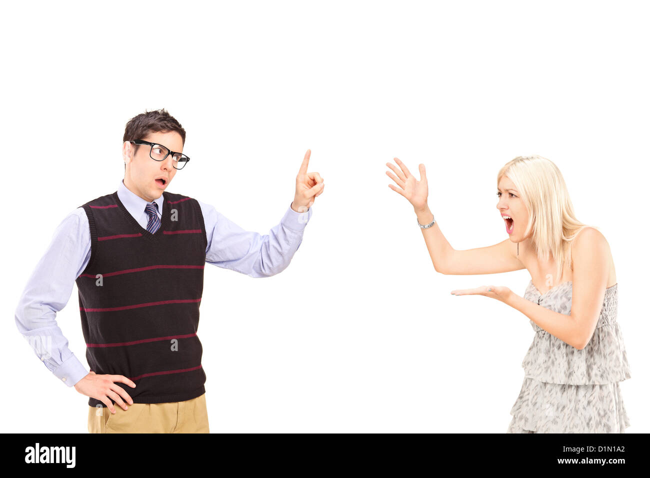 A young heterosexual couple arguing isolated on white background - Stock Image
