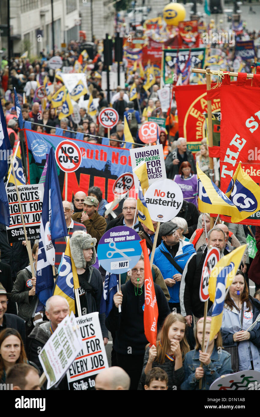The march coming up towards Piccadilly Circus. 10s of thousands turned out to demonstrate against the Government's - Stock Image