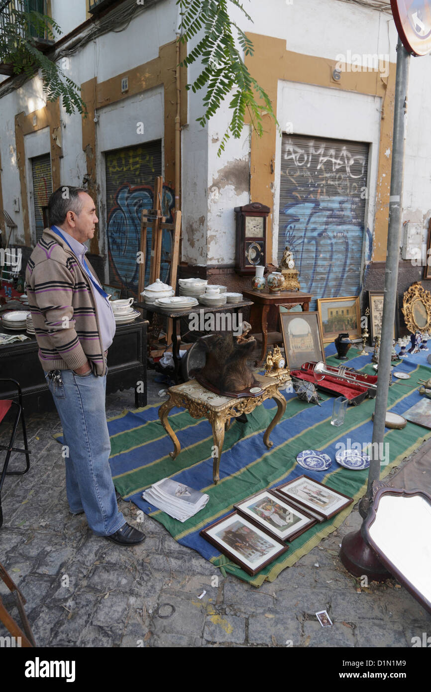 Weekly fleamarket  in la Macarena district of Seville stallholder - Stock Image