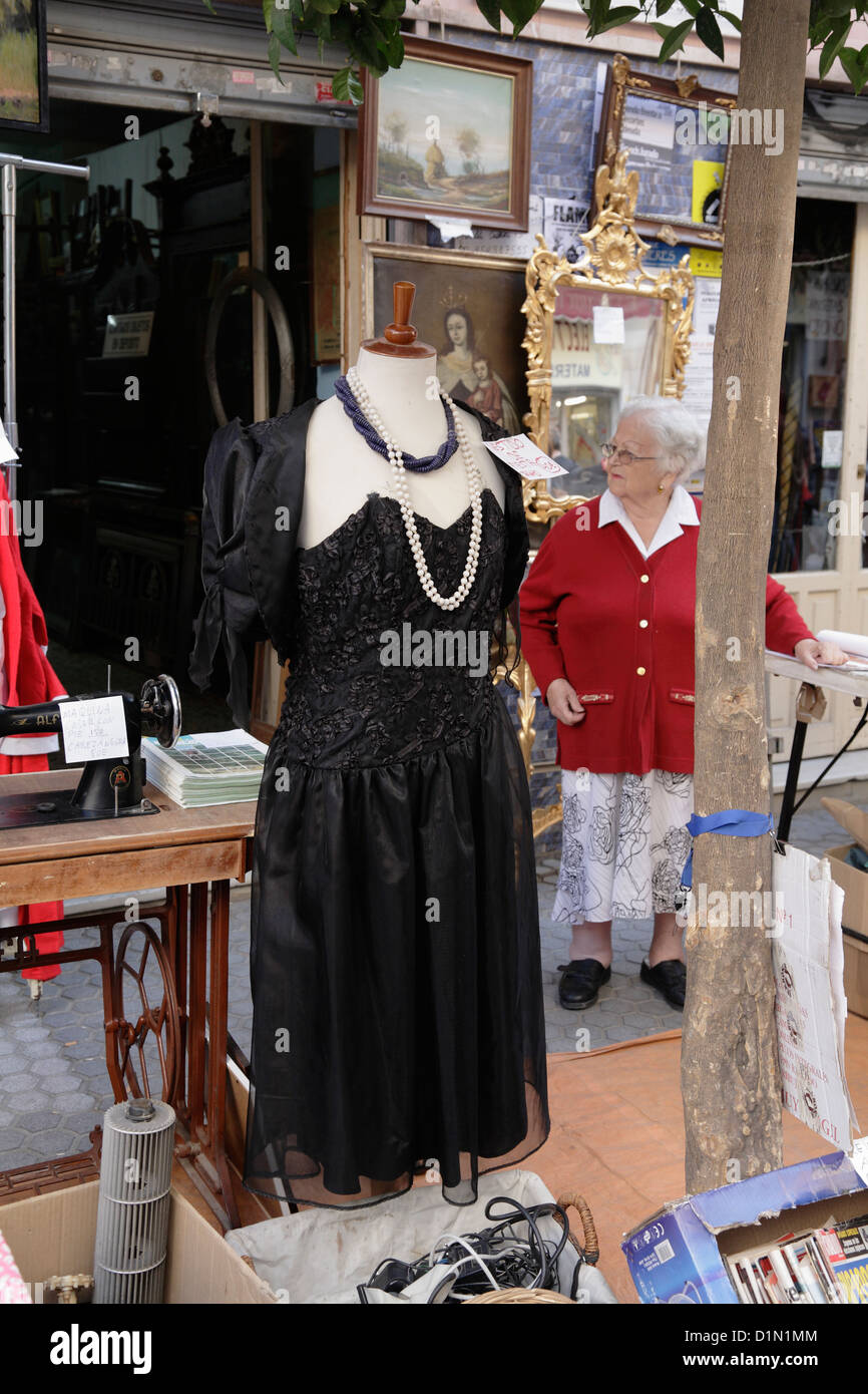 Weekly fleamarket  in la Macarena district of Seville old lady senior stallholder - Stock Image