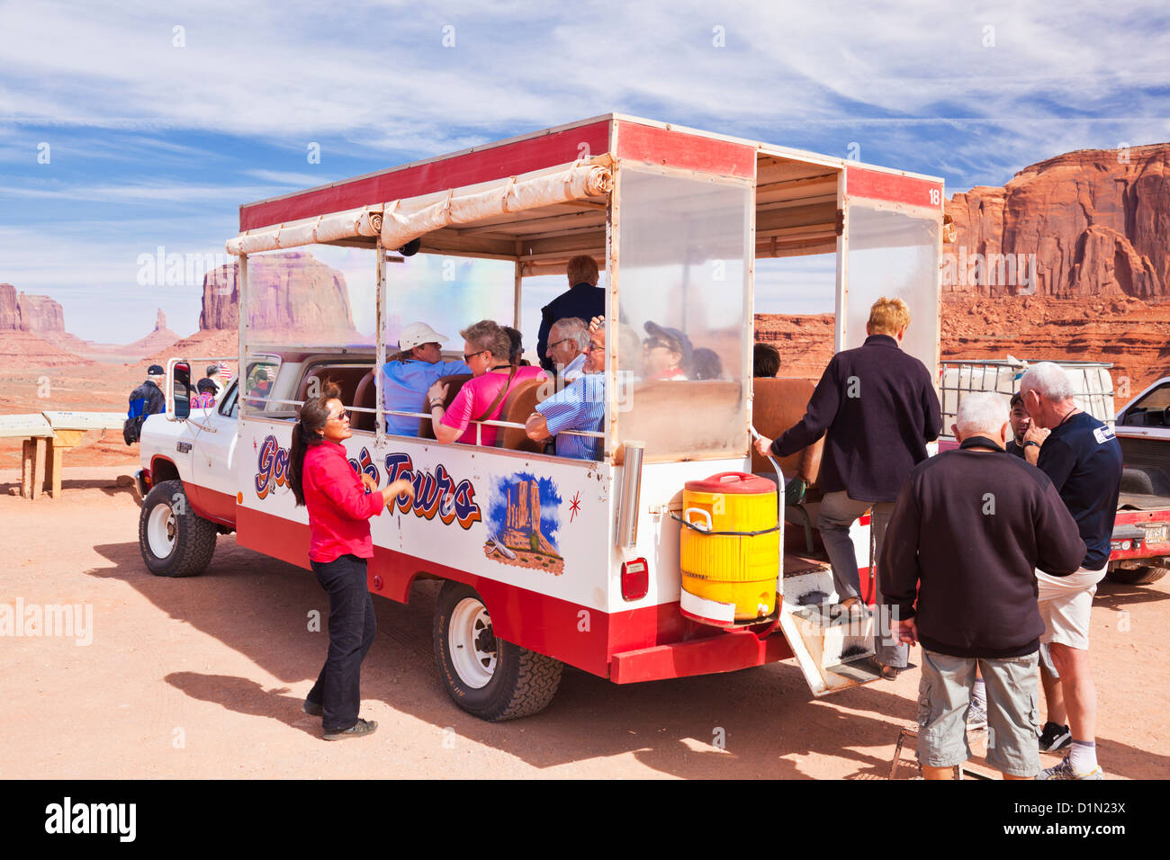 Tourists on a Jeep Tour around the Mittens and Buttes of Monument Valley Utah and Arizona USA United States of America - Stock Image