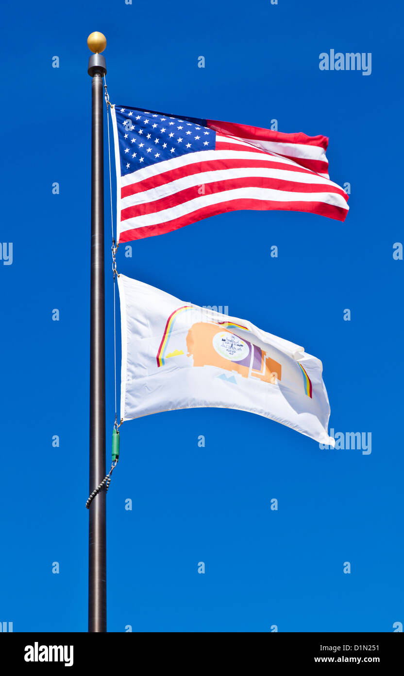 stars and stripes the american flag and the flag of the Navajo nation together flying on a flagpole - Stock Image
