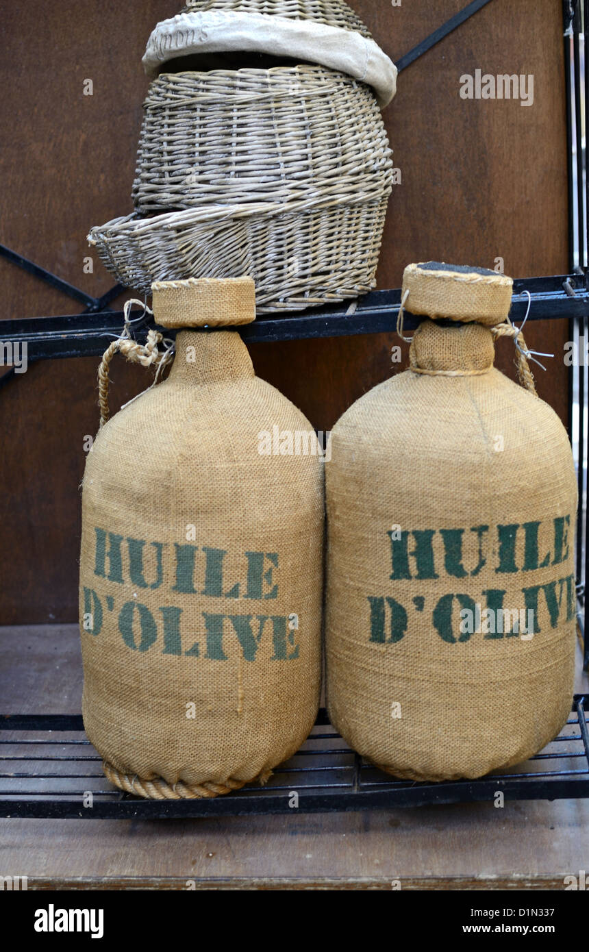 Olive Oil Bottles or Hessian Covered Containers Aix-en-Provence Provence France - Stock Image
