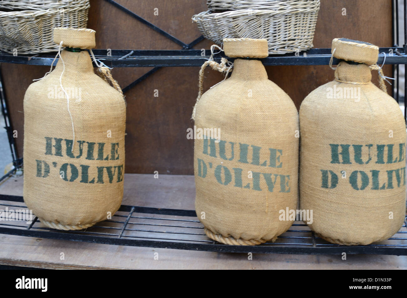 Hessian Covered Olive Oil Containers or Bottles Provence France - Stock Image