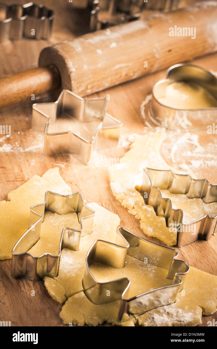 Christmas Cookie Cutters with rolling pin and dough Stock Photo