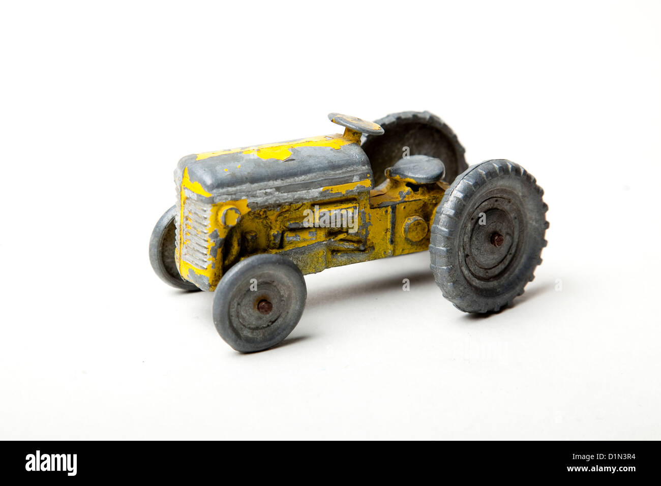 Toy yellow tractor Stock Photo