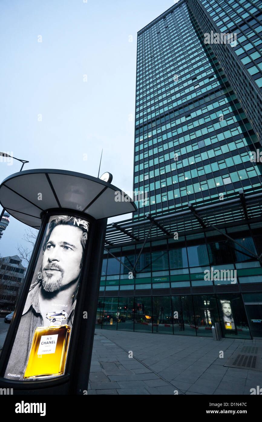 Brad Pitt's Chanel No5 ad, next to Euston Tower, Euston Road, London, England, UK - Stock Image