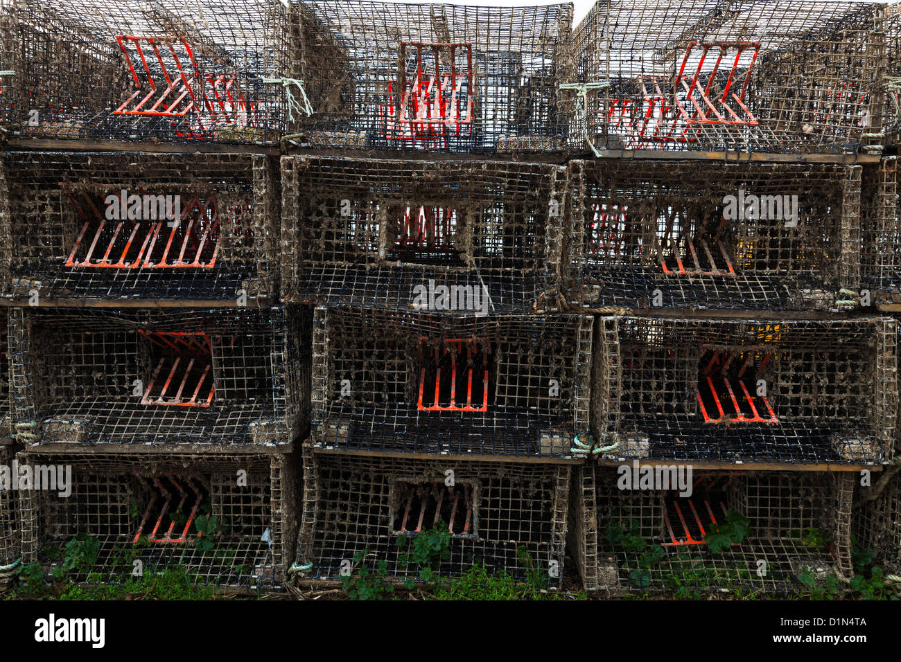 rectangular lobster pots stacked on the beach at Warsash - Stock Image