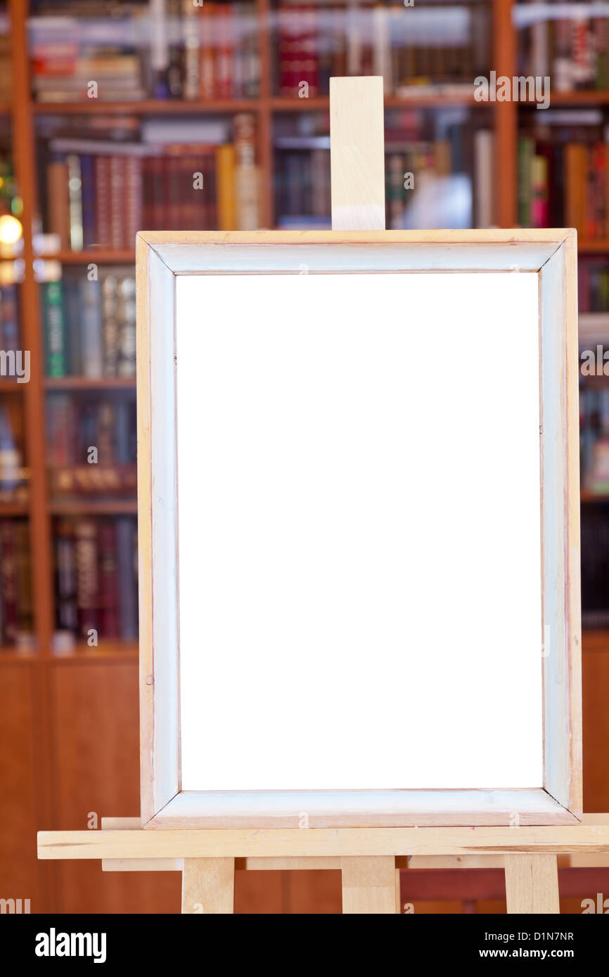 white canvas of simple picture frame on easel with clipping path and ...