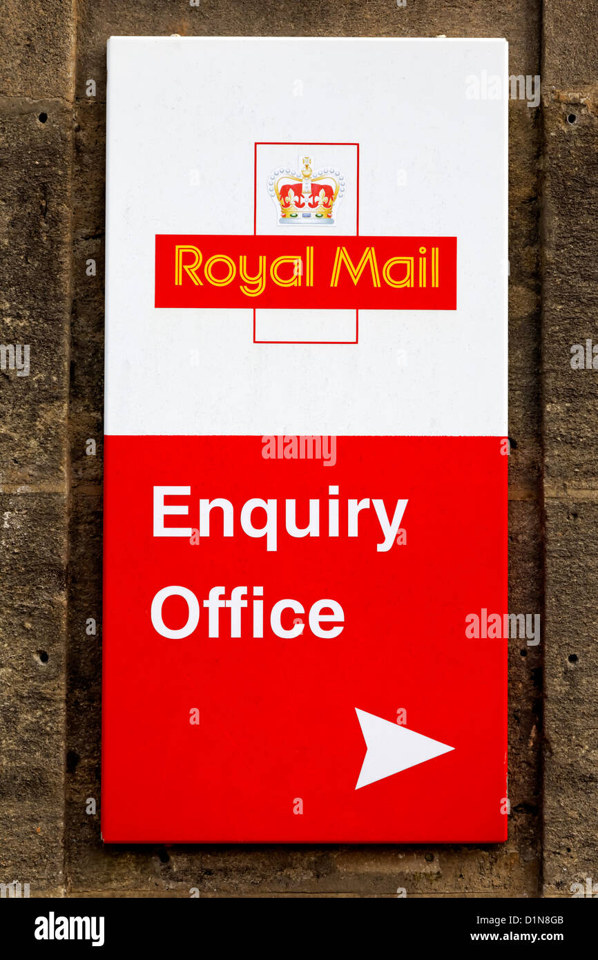 A Royal Mail enquiry office sign in the Wiltshire market town of Warminster, United Kingdom. - Stock Image