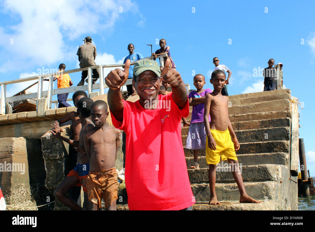 Local man and children on a jetty at Lamu Island, Kenya, East Africa - Stock Image