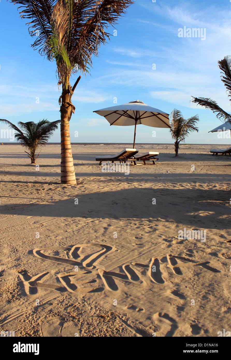 Kenya written in the sand on a beach, Malindi, Kenya, East Africa - Stock Image