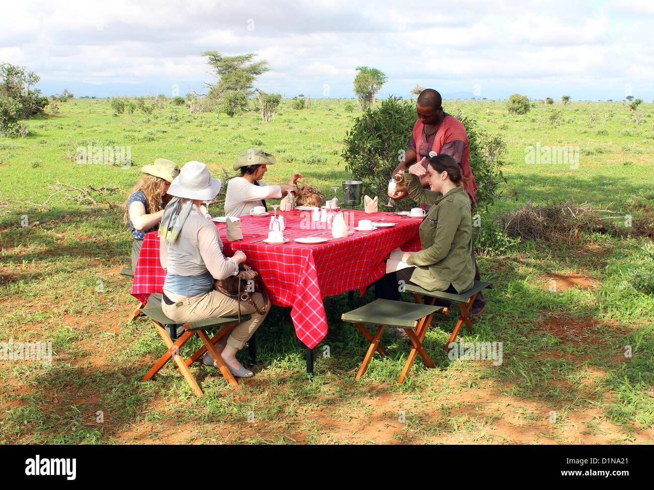 Kenya, bush breakfast provided by Ashnil Aruba Lodge, Tsavo East National Park, Kenya, East Africa - Stock Image