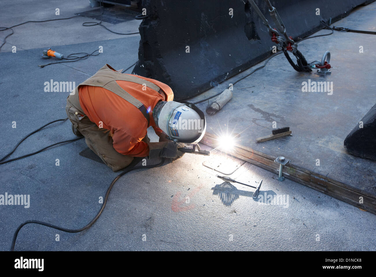 man welding metal plates together on the street Las Vegas Nevada USA - Stock Image