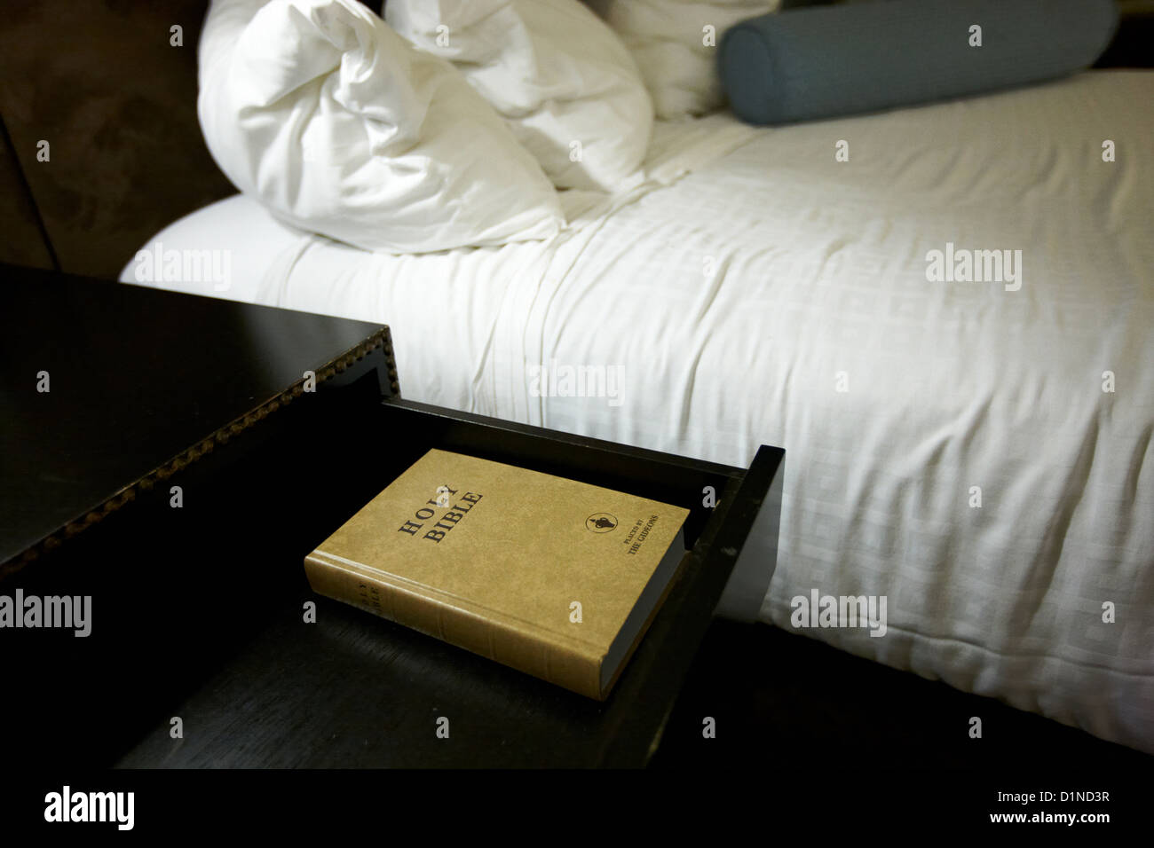 holy bible left by the gideons in a drawer at the side of the bed in a hotel room in Las Vegas Nevada USA - Stock Image