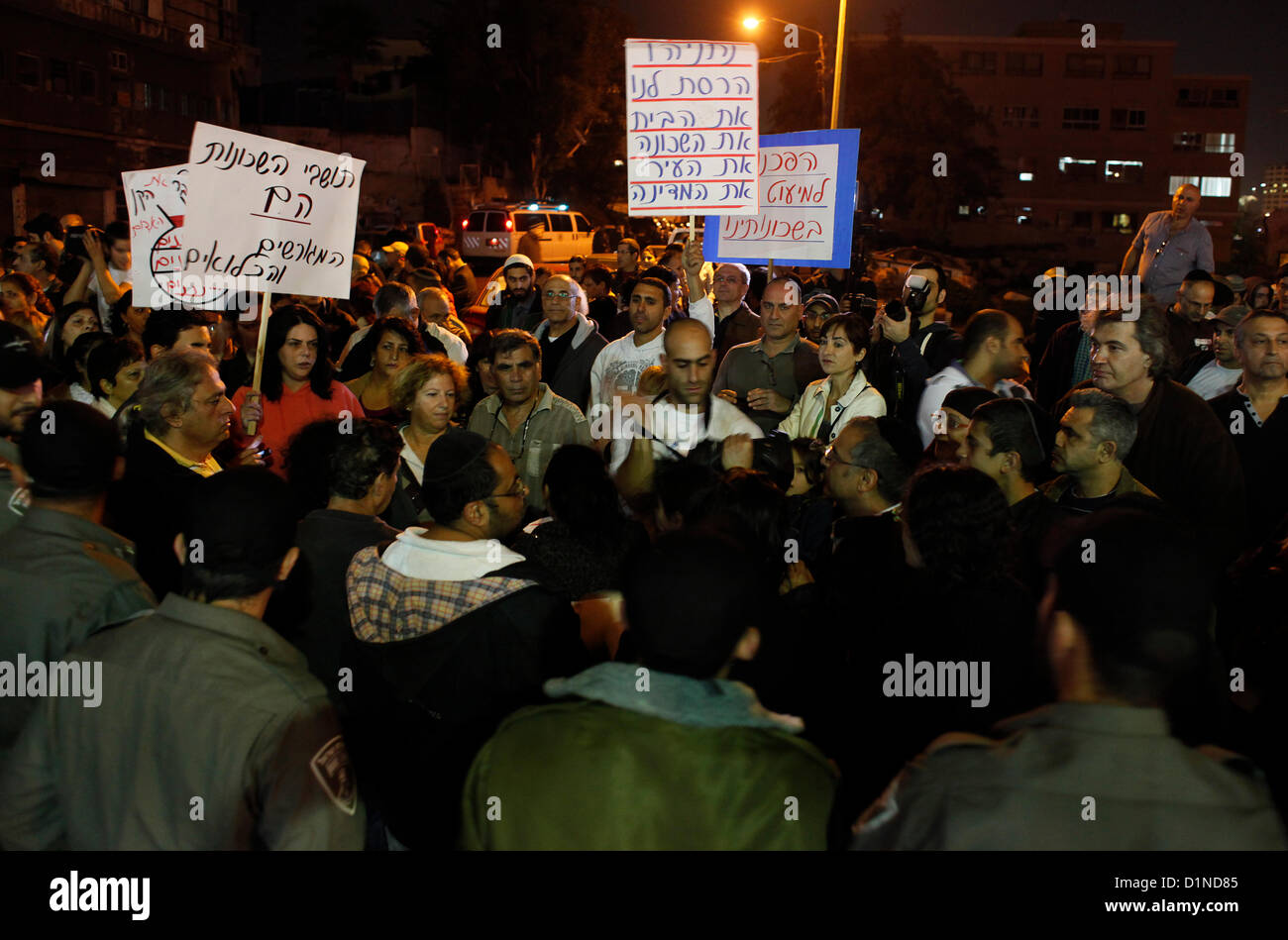 Israeli border policemen blocking anti migrant protesters in Tel Aviv in response to publication of an incident - Stock Image