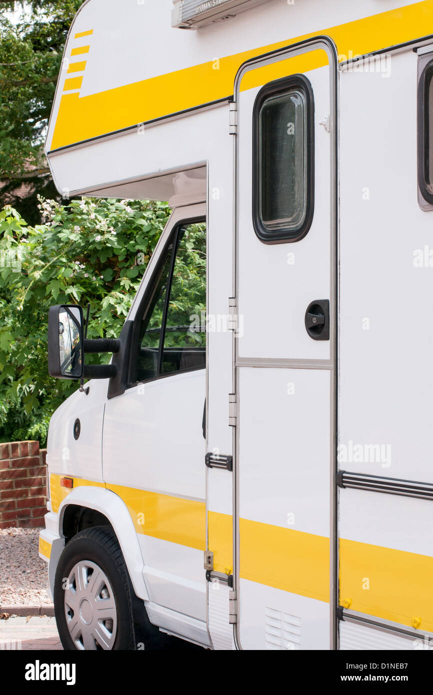 Motor Home or Camper Van, Cab view with overhead bed area, View from the side. Close up - Stock Image