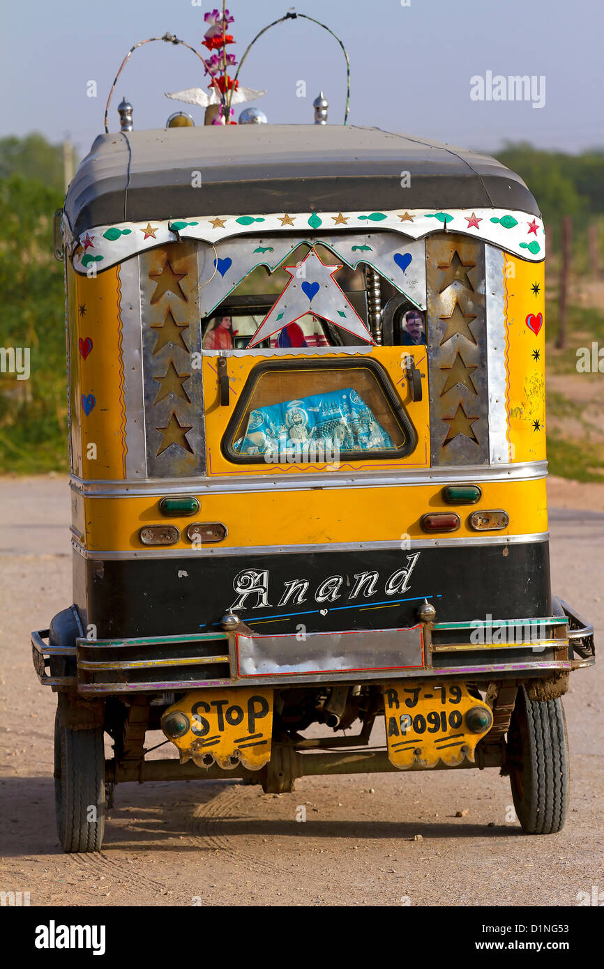 "Auto,Automobile,Conveyance,Three wheeler,Tempo,""Traditionally Indian Transport"".Speeding Rickshaw,ode of transport,Vehicle,Tempo Stock Photo"
