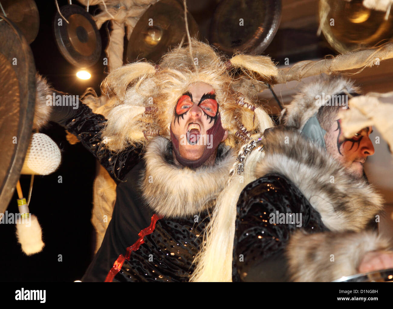 Man playing cymbal and shouting on float Newcastle new years eve 2012 party or winter carnival north east England Stock Photo