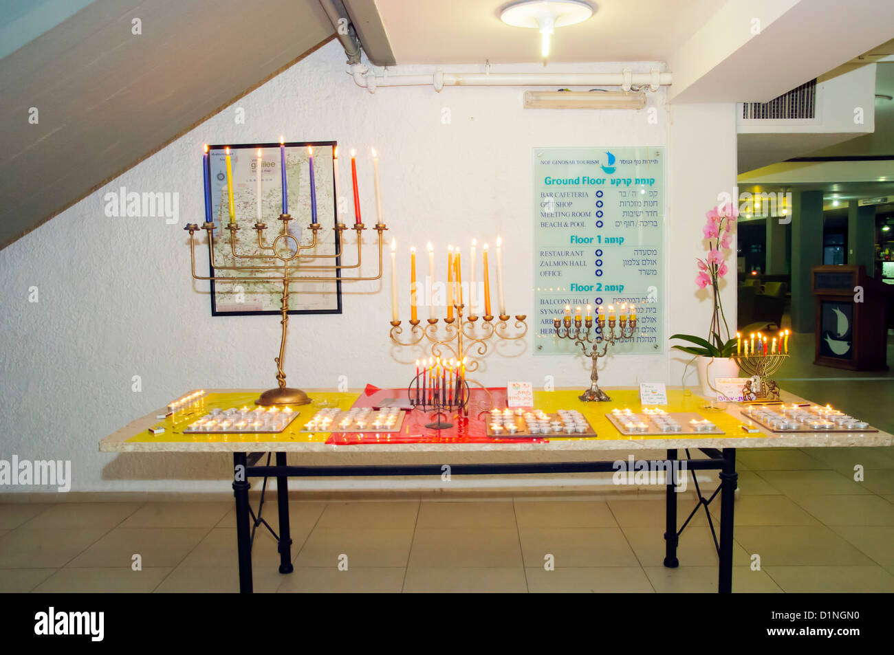 Hannukah Menorah with burning candles - Stock Image