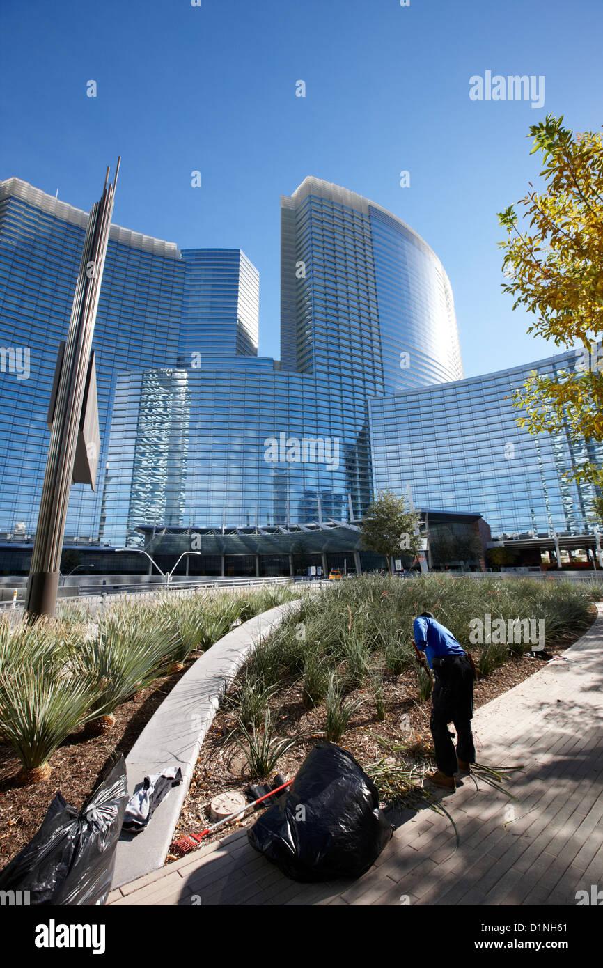 Hispanic Gardener Tending Public Garden In The Citycenter Complex Las Vegas  Nevada USA