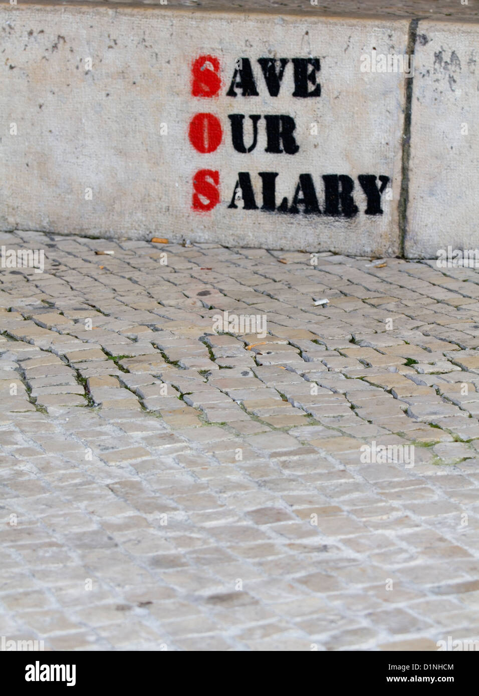 Graffiti in Lisbon Portugal SOS Save Our Salary referring to the economic Eurozone crisis - Stock Image