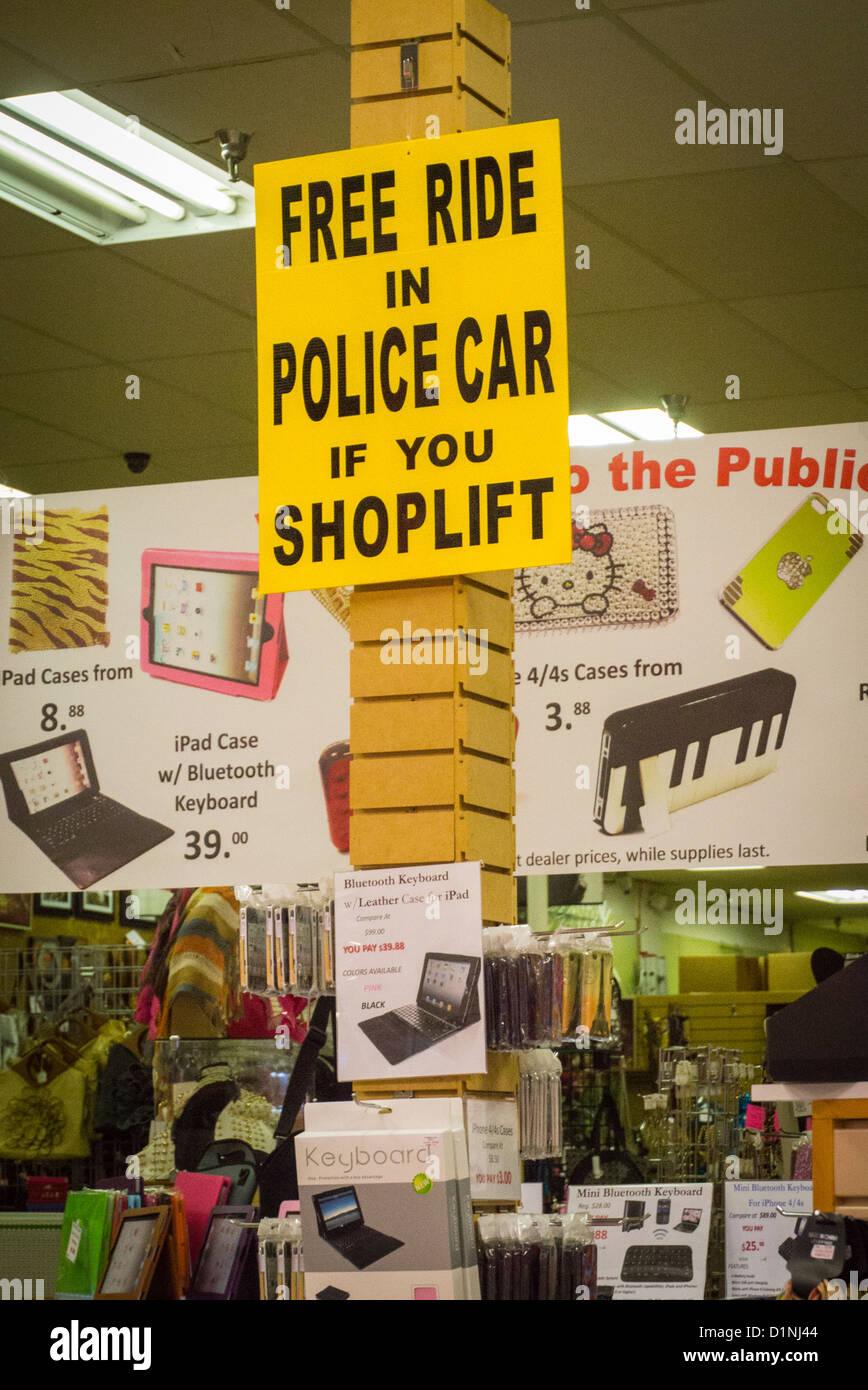 USA Florida Boca Raton Festival Flea Market Mall shop store funny amusing sign ' Free Ride in Police Car if - Stock Image