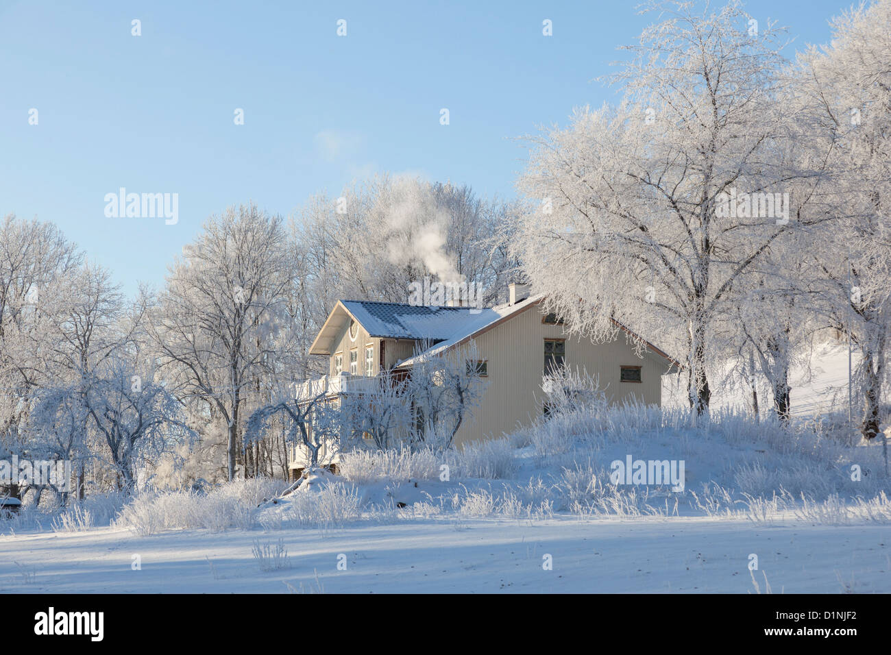 Old house in winter landscape - Stock Image