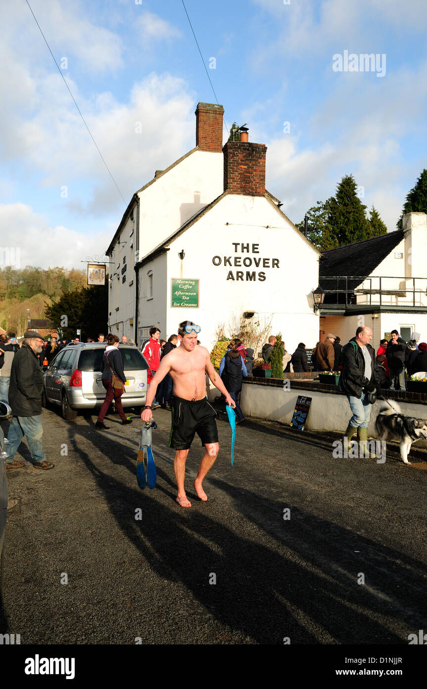 Mapleton,UK.1st January 2013. 20 pairs of brave participants take the plunge for charity as they paddle their rafts, - Stock Image