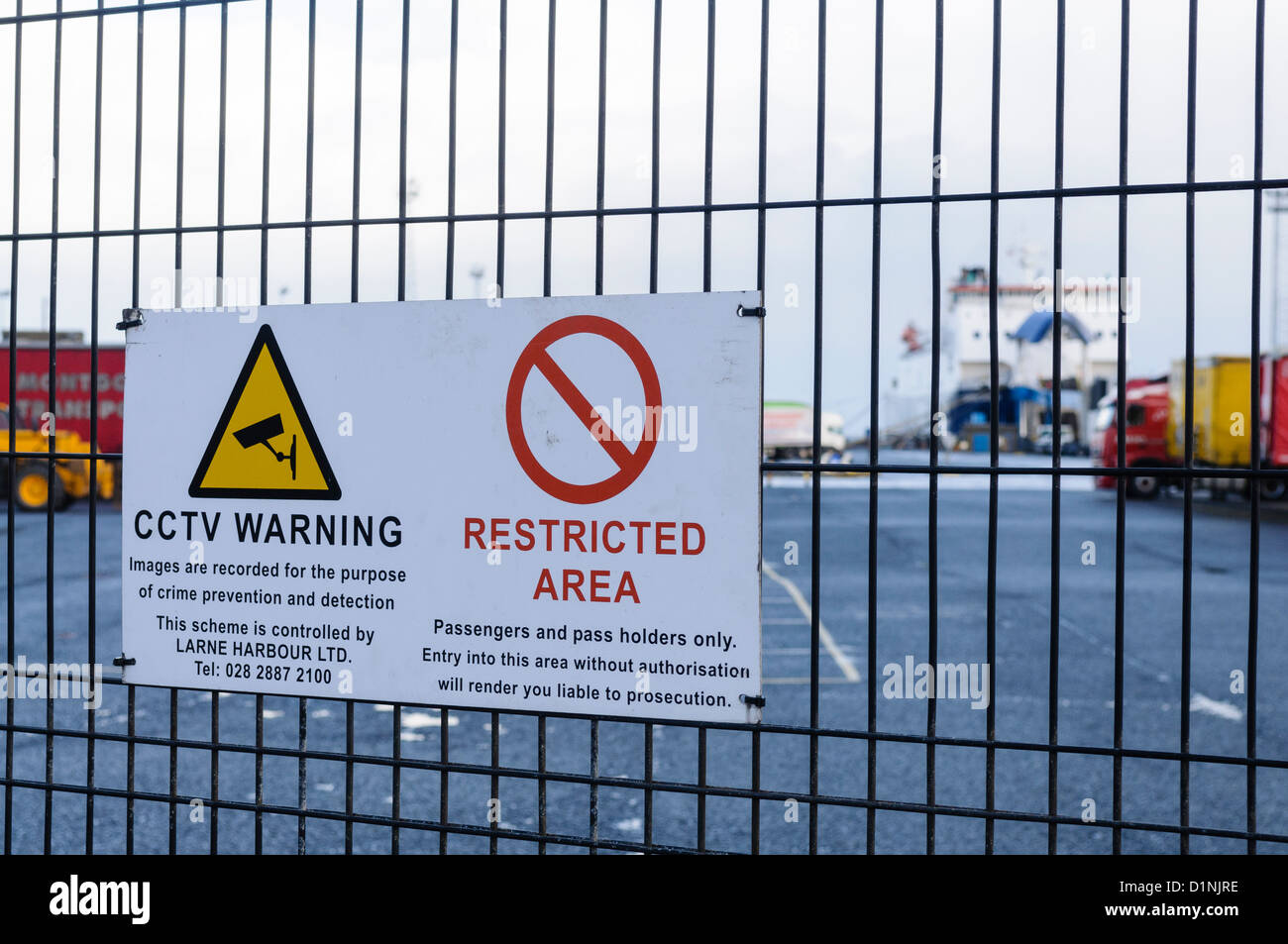 Sign at the Port of Larne ferry terminal and harbour, warning that this is a restricted area and that CCTV is in - Stock Image