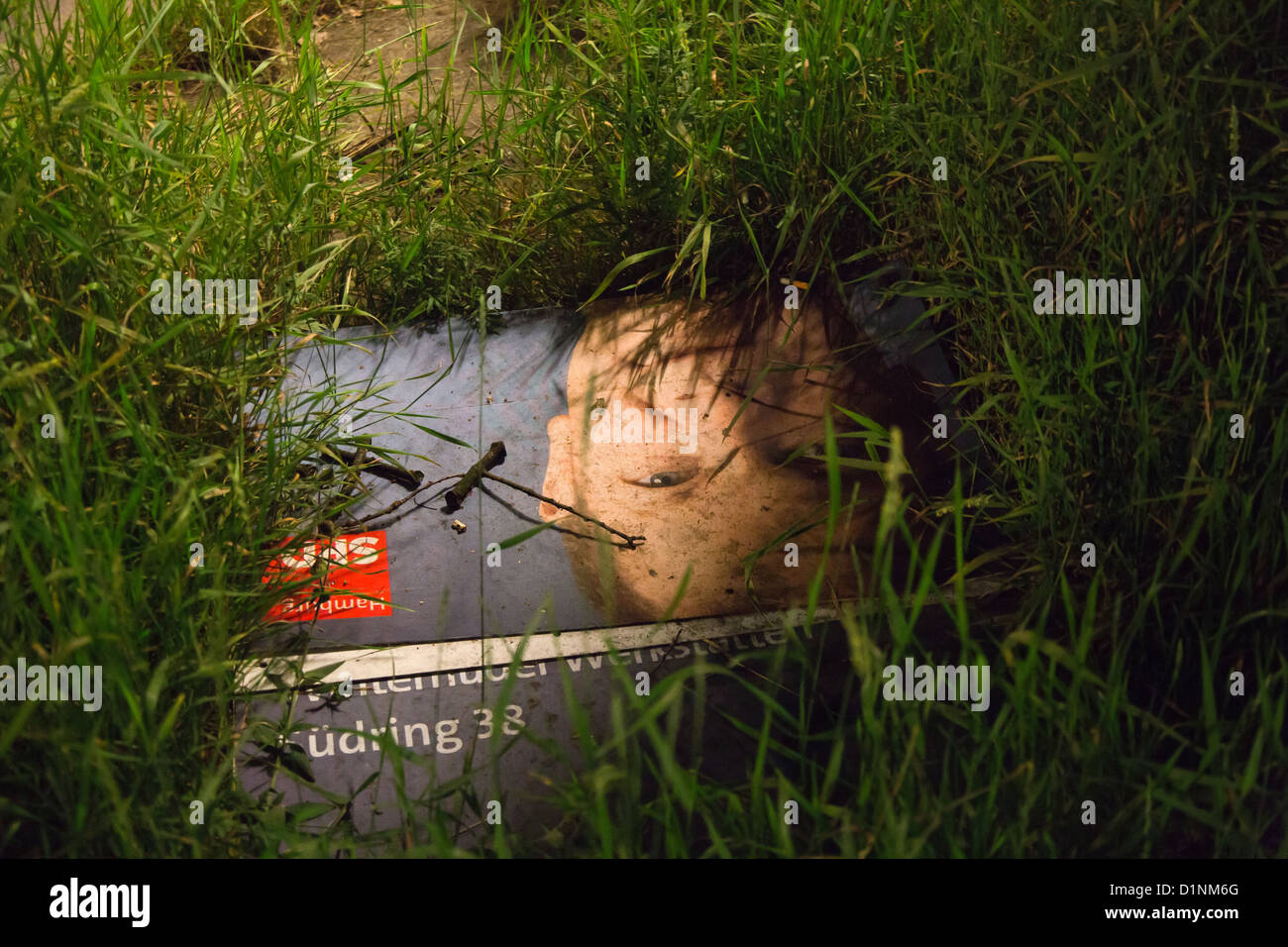 Hamburg, Germany, lying in the grass election poster with Olaf Scholz - Stock Image