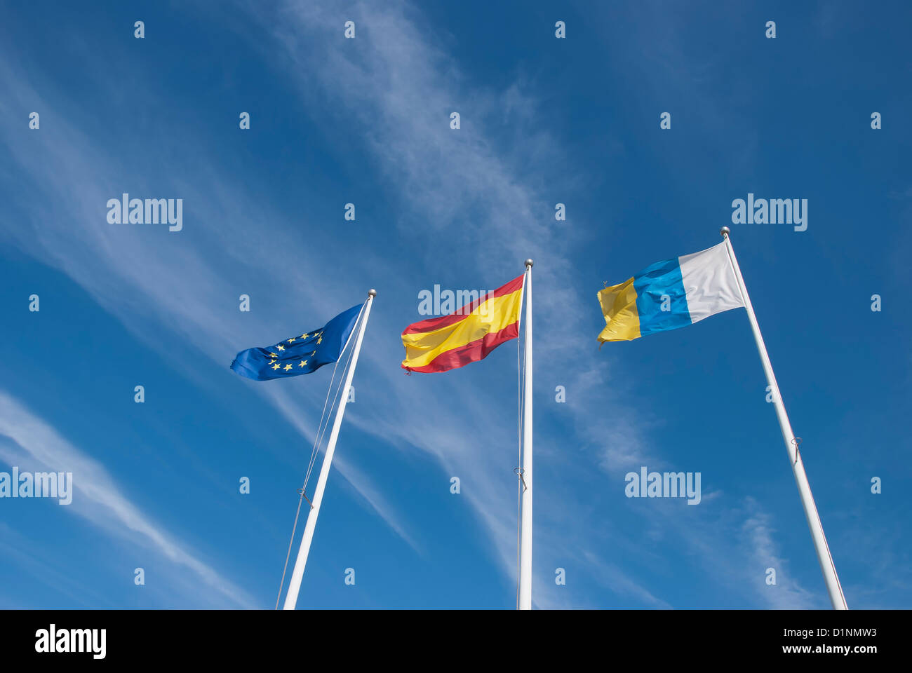 The Flags of the European Union,Spain and the Canary Islands under a blue sky Stock Photo