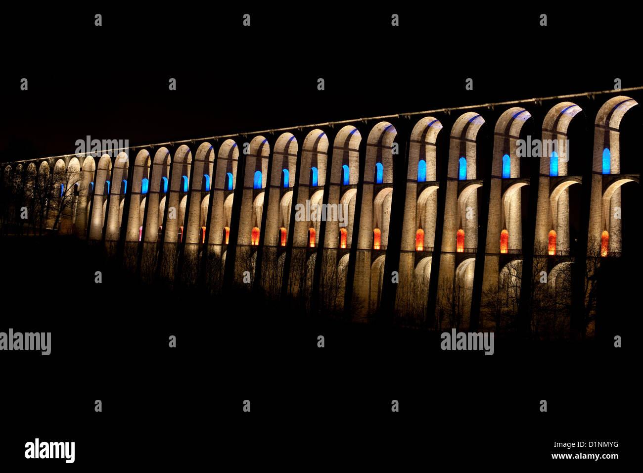 LED LIGHTS ILLUMINATING THE CHAUMONT VIADUCT. Historic railroad viaduct (built 1857) on the Paris-Basel line. Haute - Stock Image