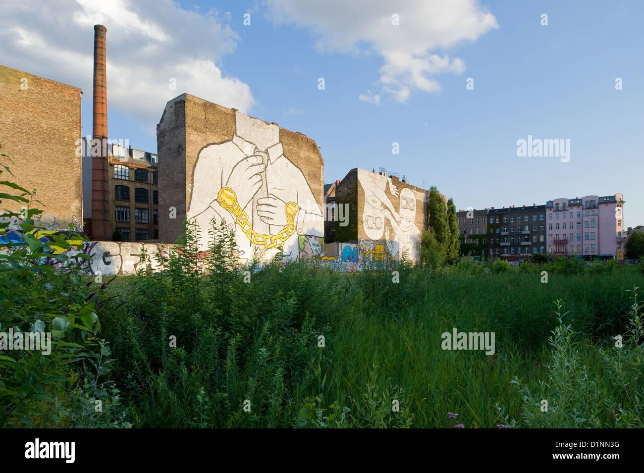 Berlin, Germany, fire walls with murals on the Mediaspree terrain - Stock Image
