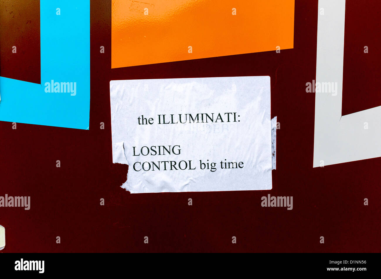 Sticker proclaiming that the Illuminati are losing control - Stock Image